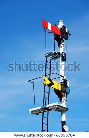 Railway signal against a blue sky background. North Yorkshire UK - stock photo