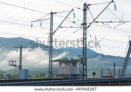Railway signal-box  near the bridge in the mountains - stock photo