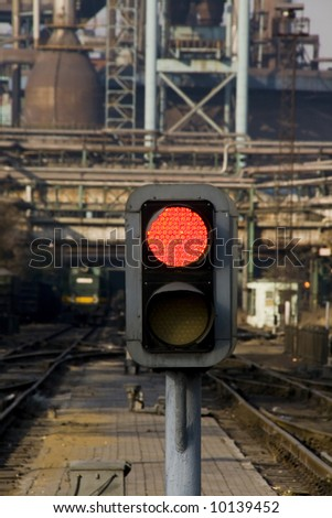 railway signal gantry showing a red light Prohibition air pollution - stock photo