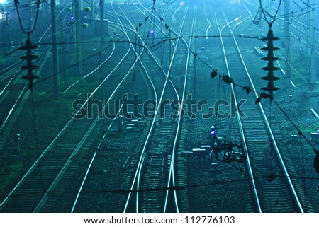 railway station at night in blue - stock photo