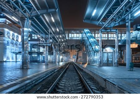 Railway station at night. Train platform in fog. Railroad in Donetsk.  - stock photo