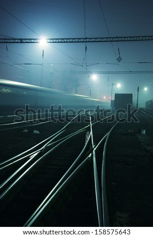 Railway station in the night. Tone is blue - stock photo