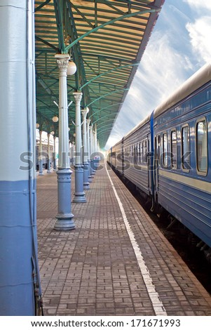 Railway station with train in summer. - stock photo