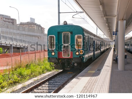 Railway station with train. Italy - stock photo