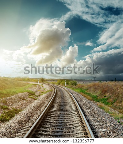 railway to horizon in sunset - stock photo