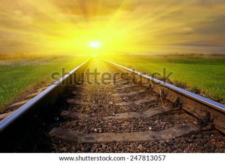 Railway to sunset - stock photo