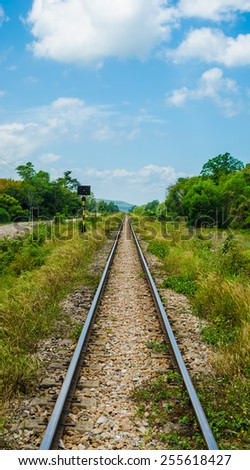 Railway track in a rural scene (vertical) - stock photo