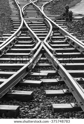 Railway track junction with points lever - stock photo