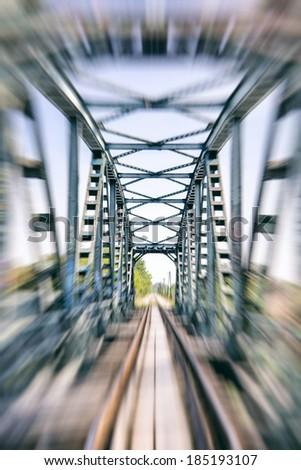 railway track on bridge blurred,train speed , - stock photo