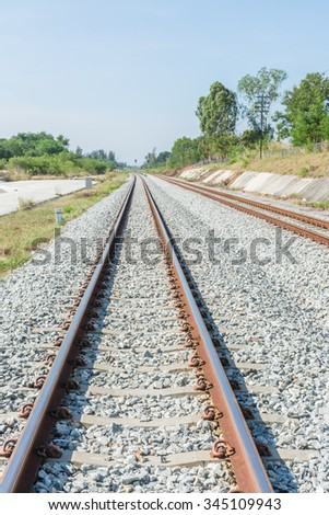 Railway track on day time - stock photo