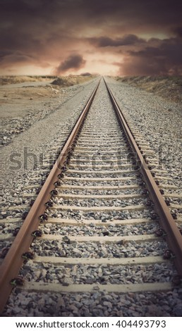 railway track with vintage look disappearing into the far distance - stock photo