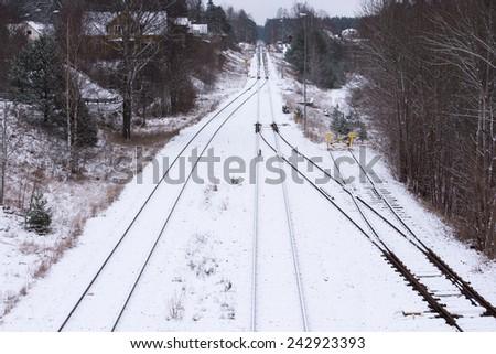 Railway tracks of the railroad berga-Oskarshamn in the eastern part of Smaland Sweden, in winter - stock photo