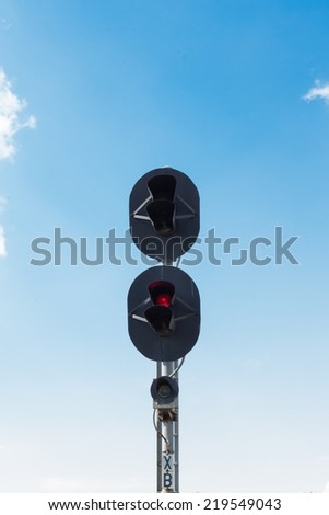 railway traffic lights on red and sky background - stock photo