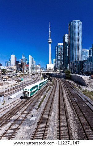Railway train at Toronto with Canada tower as background - stock photo