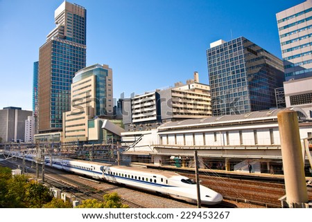 Railway with skyline shinkansen at Odaiba ,Tokyo, Japan. Shinkansen is world's busiest high-speed railway operated by four Japan Railways companies. - stock photo
