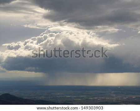 """Rain cloud over the Rhine valley, view from the observation tower at the """"Schauinsland"""" mountain, Black Forest, Baden-Wuerttemberg, Germany - stock photo"""