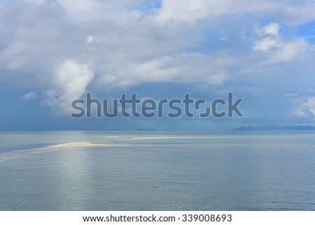 Rain cloud with bright blue sea and sky background - stock photo