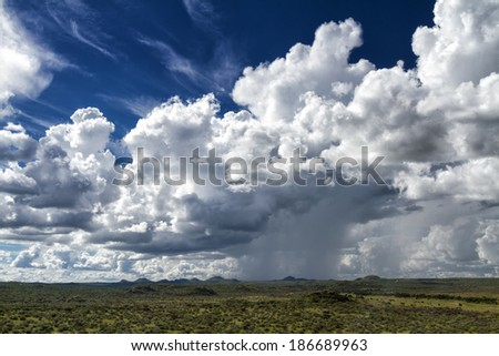 Rain Clouds over the namibian savanna near Windhoek, Namibia - stock photo