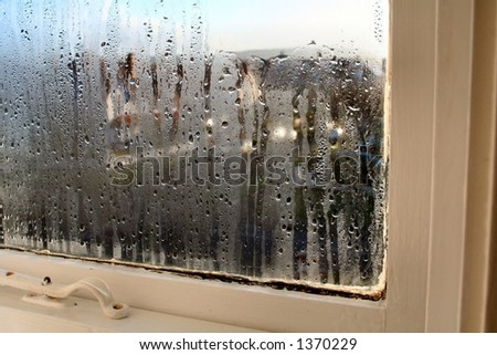 Rain covered window - stock photo