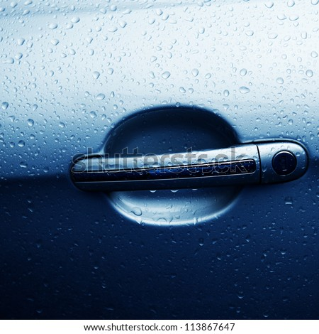 rain drop on door handle of car - stock photo