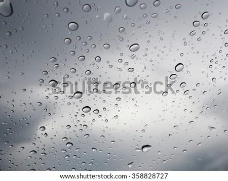 Rain drop on mirror. - stock photo