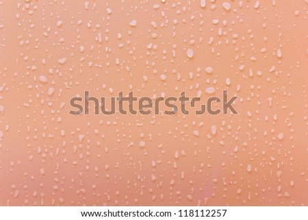 Rain droplets on the pink background. - stock photo