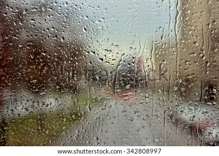 Rain drops covering window glass - stock photo