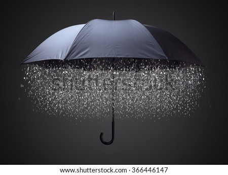 Rain drops falling from inside a black umbrella concept for business and financial problems, challenge or insurance protection - stock photo