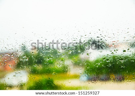 Rain drops on a Window. - stock photo