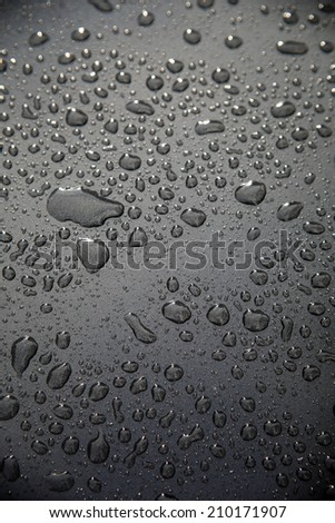 rain drops on car - stock photo