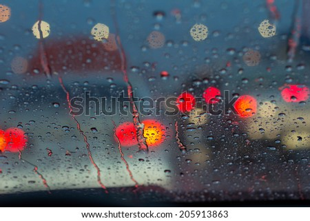 rain drops on car glass - stock photo