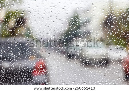 rain drops on car glass in rainy days - stock photo