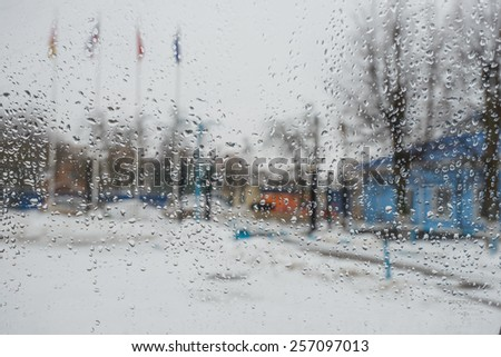 rain drops on glass with a background - stock photo