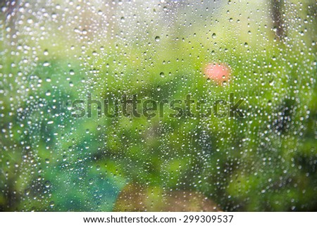 Rain drops on the car window. Abstract background - stock photo