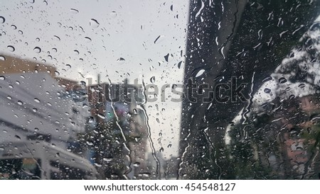 Rain Drops On The Glass and traffic jam - stock photo