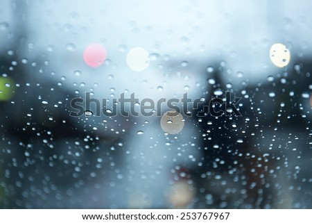 Rain drops on the window. Abstract background. - stock photo