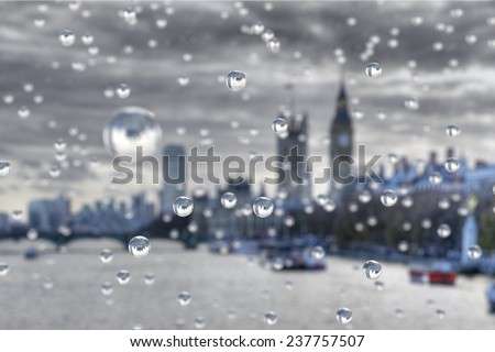 Rain in London. Rain drops focus the scene behind. - stock photo