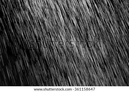 rain on a black background - stock photo