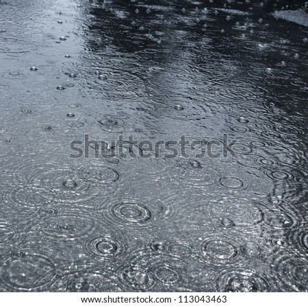 rain on a street - stock photo