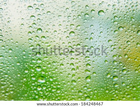 rain on glass rain outside the window - stock photo