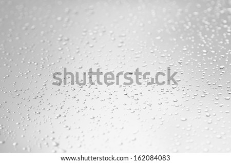 Rain on the inclined window at foggy day. - stock photo