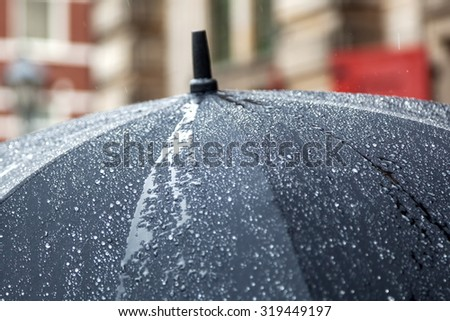 rain umbrella with rain drops - stock photo