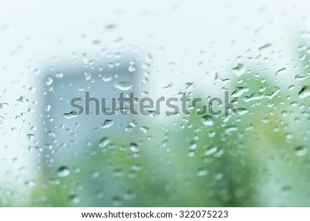 Rain water drops on window glass surface background. Abstract Backdrop - stock photo