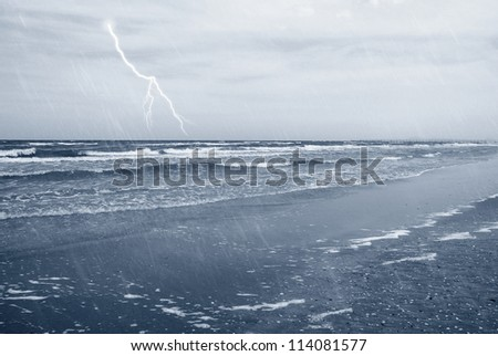 rain with lightning over the sea - stock photo