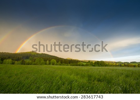 rainbow after storm - stock photo
