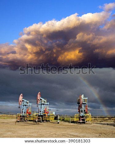 Rainbow and oil pumps  - stock photo