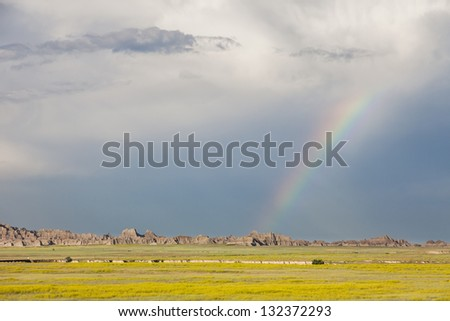 Rainbow and storm clouds over Badlands National Park, South Dakota, USA - stock photo