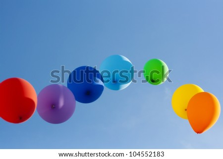 rainbow ballons in the sky - stock photo