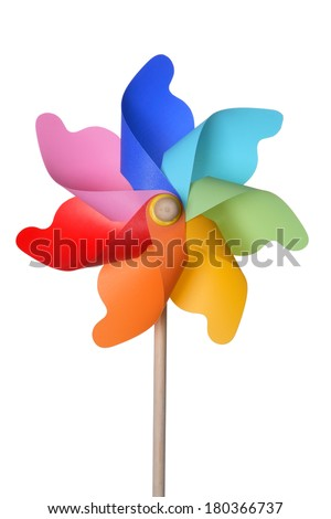 Rainbow colored pinwheel on white - stock photo