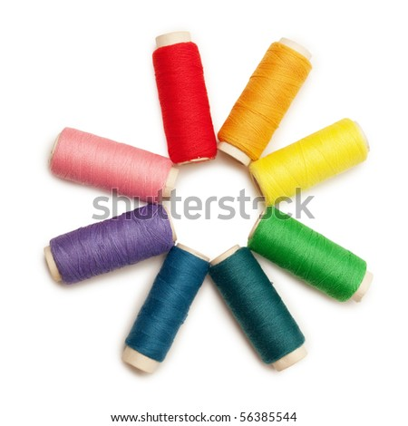 rainbow colored set of threads over white background - stock photo